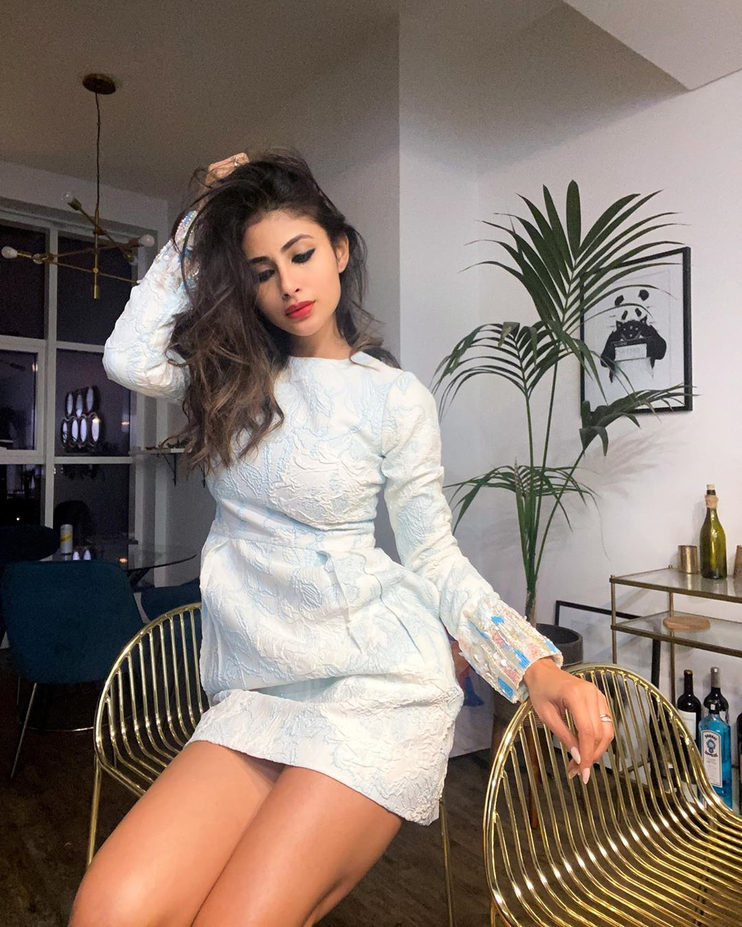Mouni Roy sets fans' hearts aflutter as she has a fashion moment in her little white dress